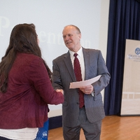 3MT People's Choice winner Chelse Hawkings shaking hands with the dean of the graduate school